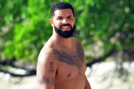 Famous Rapper Drake Spotted at Barbados Beach Soaking In Sun with plenty of eyes moving at him